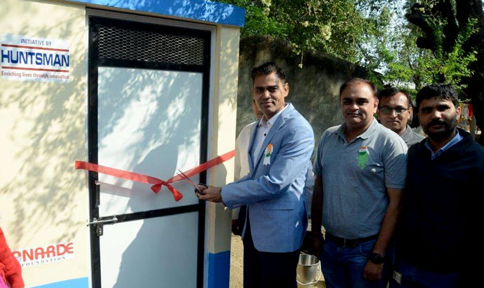 """Huntsman, the global manufacturer and marketer of differentiated chemicals today announced that it has built 60 individual household latrines (IHHLs) at Bakrol village, Ankleshwar in Gujarat as part of its Corporate Social Responsibility program. The announcement was made at an inaugural event held in Bakrol on Saturday.   Many of the usable toilets in Bakrol village are used for bathing or for storage purpose. As a result, prior to the addition of the new toilets, only 5 per cent of the existing toilets were in usable condition. Huntsman's CSR initiative aims not only to provide more toilets, but also to educate the community regarding the importance of good sanitation and hygiene. Through informative sessions, Huntsman is communicating the benefits of using toilets, encouraging participation in the project, educating on the ill effects of open defecation, and suggesting maintenance techniques. Huntsman to further evaluate addition of more toilets to take the total to 120 in 2019.  Commenting on this development, Rajib Kumar, Chair of CSR Committee and HR Head India Subcontinent, Huntsman Corporation, said, """"We firmly believe that everyone should have access to basic sanitation, and stand committed to it. Our Corporate Social Responsibility initiative in Bakrol aims not only to improve infrastructure, but also alter mindsets on hygiene. At Huntsman, it gives us immense pride in contributing to the well-being of the community.""""   Speaking on the occasion, Vipul Patel, Site Head, Huntsman Ankleshwar Plant, said, """"We at Huntsman have a strong vision for community development and it mirrors in the work we do in areas that we operate. Empowering communities while co-existing with them has been our prime objective ever since we began   work in Bakrol along with the other parts of the country. This initiative is our step towards educating people on the importance of basic sanitation thereby building a better community.""""  The inaugural event was graced by several of Bakrol"""